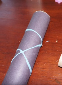 we added a rubberband to hold the paper in place while the glue dried