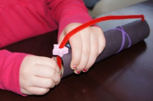 then slid the end of the pipe cleaner into the pre-cut slits